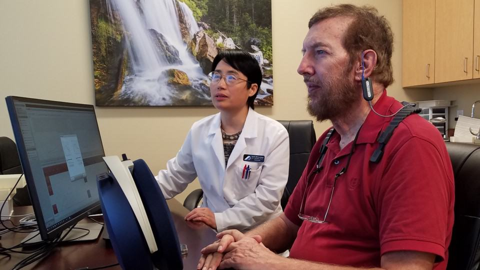 Dr. Li with hearing patient