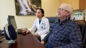 Dr. Li-Korotky administering hearing test