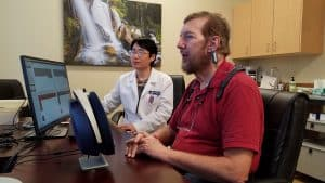 Dr. Li-Korotky administering hearing examination